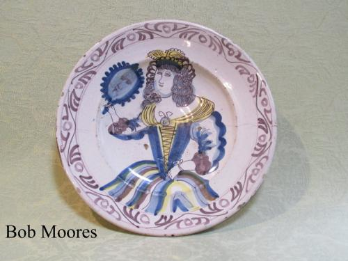 "Good late 17th century ""looking glass"" delft charger 12 1/4"" wide"
