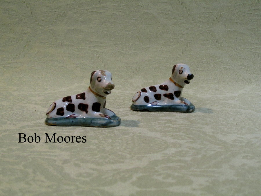 Two charming 18th century miniature delft figures of dogs