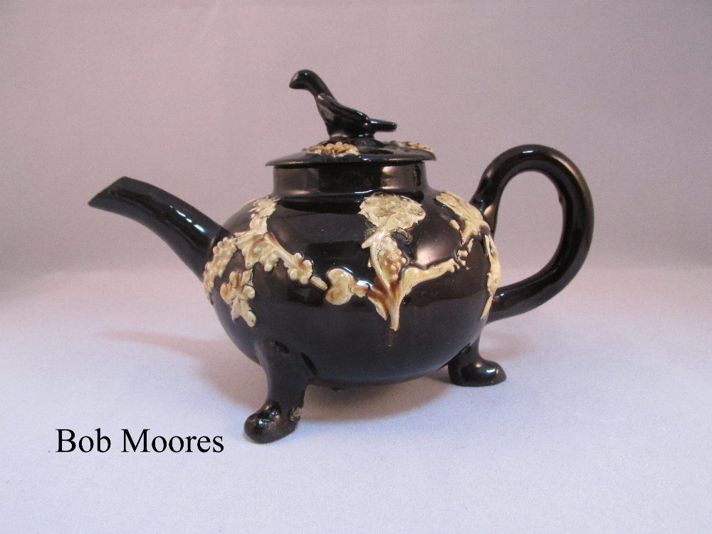A charming Astbury type sprigged teapot and lid Staffordshire c1760