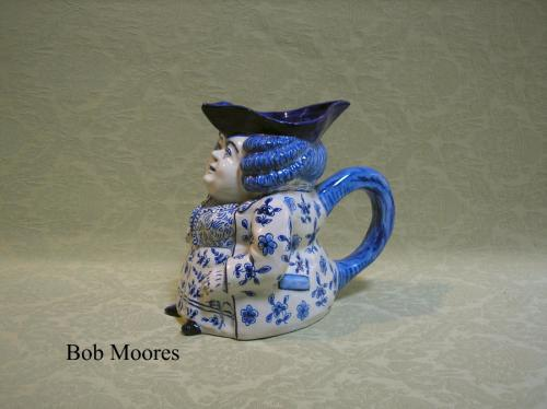 19th century Continental delft female toby jug
