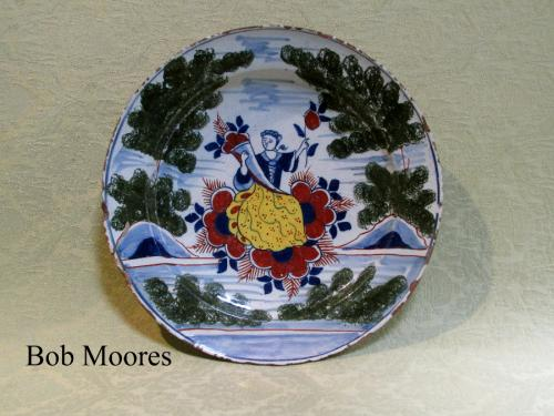 Vibrant early 18th century delft polychrome charger depicting Spring