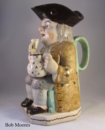 An interesting raised glass pearlware Toby jug Staffordshire c1790 -1800