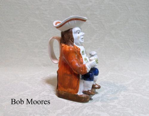 Mid sized raised glass Toby jug Staffordshire c.1790