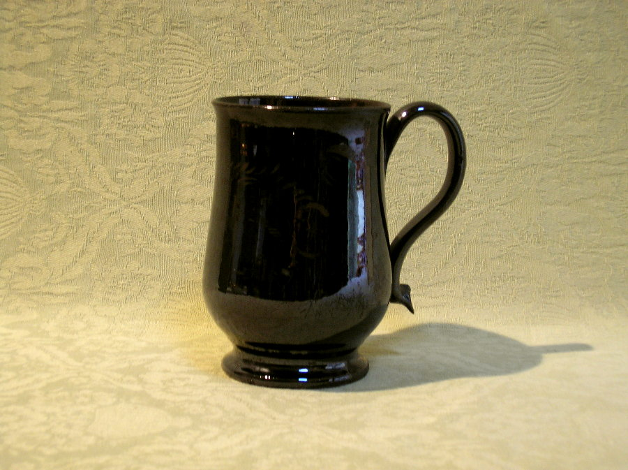 Mid sized Jackfield tankard inscribed John Jacob 17?? c.1770