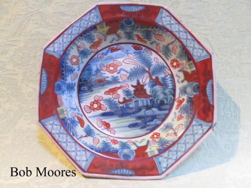 Attractive mid 18th century delft octagonal dish with clobbered decoration.