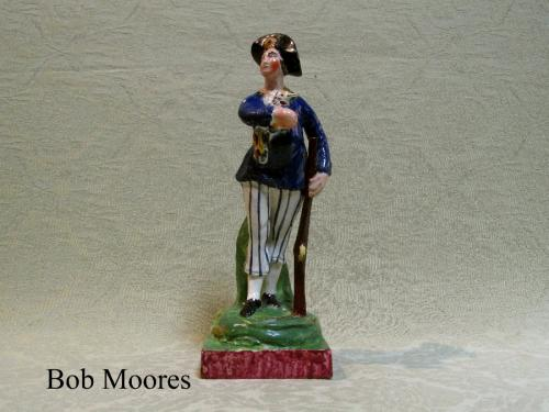 Good Staffordshire earthenware figure of a hunter c.1810