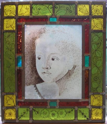 Stained glass panel of a young girl