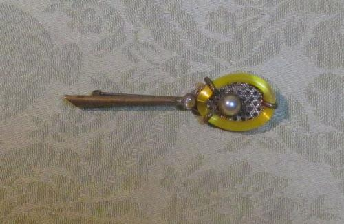 Attractive period tennis raquet brooch