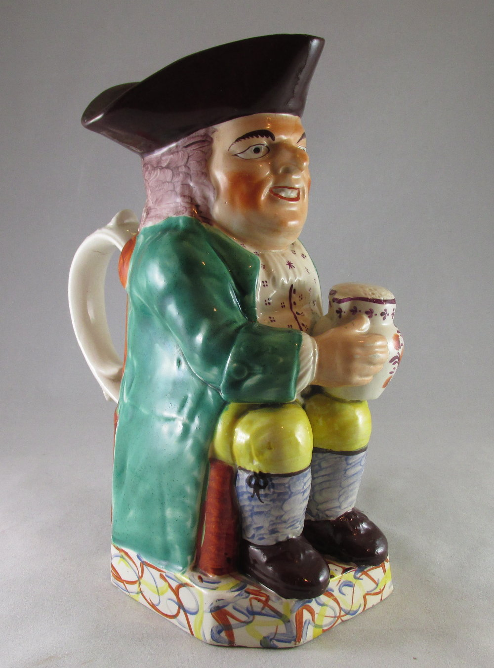 Well decorated Staffordshire Toby jug c 1820