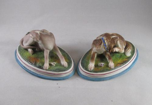 Charming pair of bisque hounds