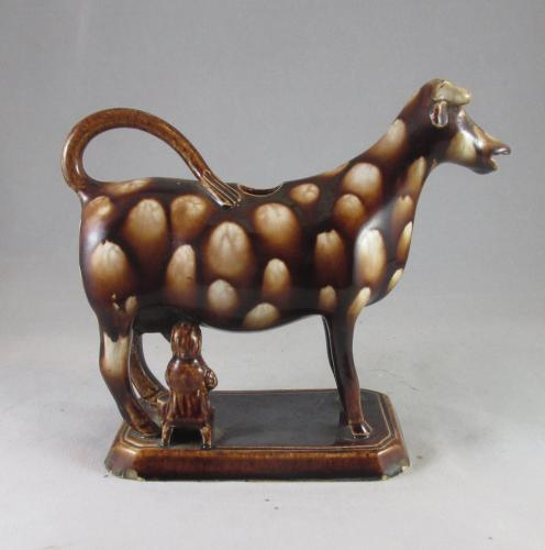 Mottled brown cow creamer Staffordshire c.1810