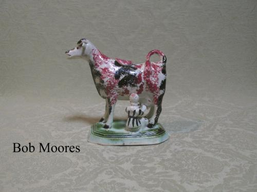 Good Staffordshire cow creamer with milkmaid and original stopper c.1800