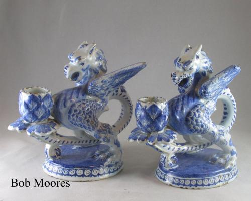 A pair of 19th century delft Griffin chambersticks