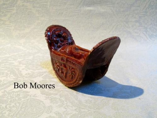 Unusual treacleglaze whistle in the form of a cradle Staffordshire c.1820