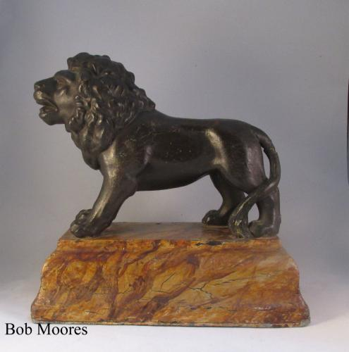 19th century cast iron figure of a lion on faux marble base
