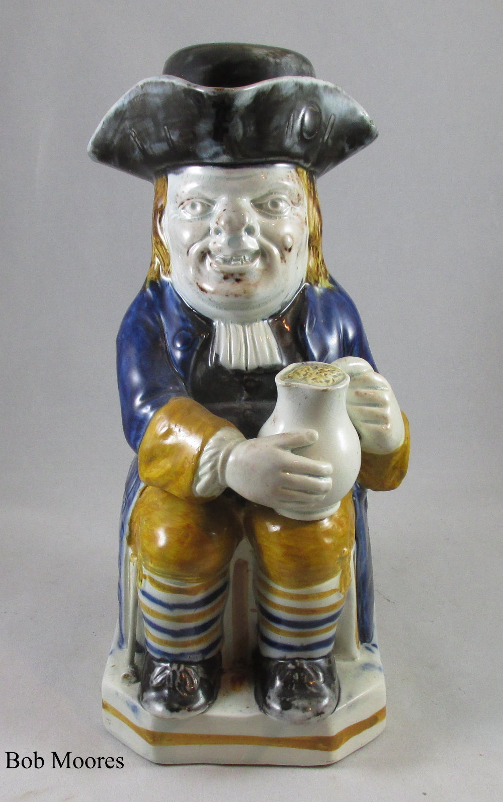 Very good pearlware Toby jug and original cap c1780