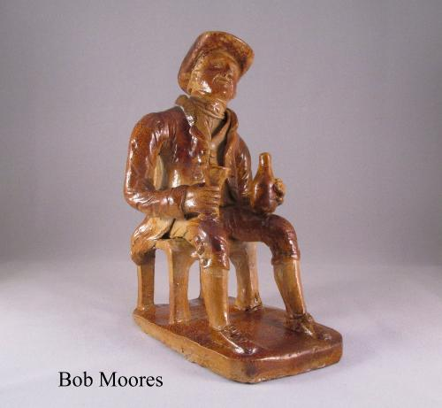 Saltglazed stoneware figure of a seated country gentleman c.1840