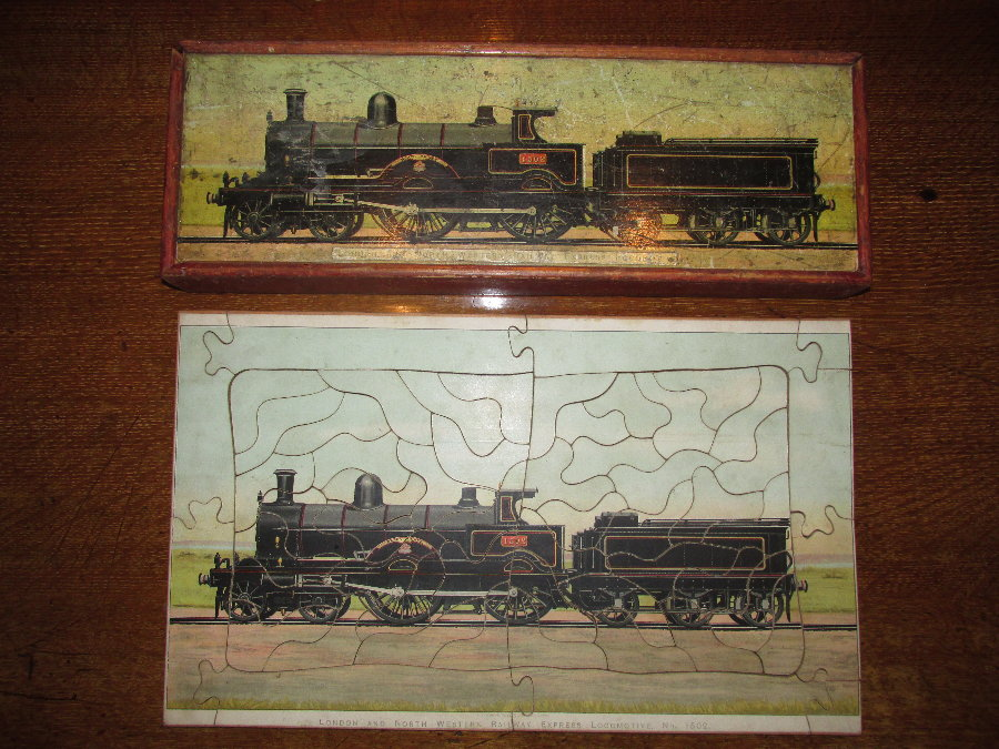 W Peacock double dissected jigsaw puzzle of two locomotives (double sided) 1890 -1900