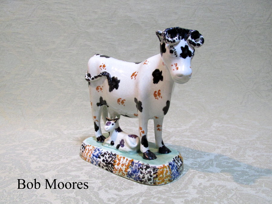 Good prattware figure of a cow with calf Yorkshire c.1800